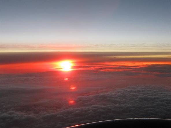 zonsopgang vanuit vliegtuig